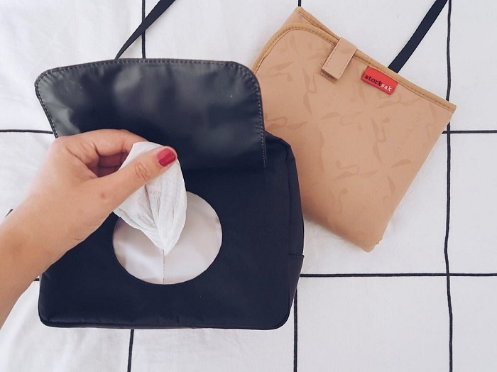 If you're looking for a super compact changing bag, you'll love this Storksak Mini Fix Review! It's a small, stylish and practical alternative to a typical nappy bag.