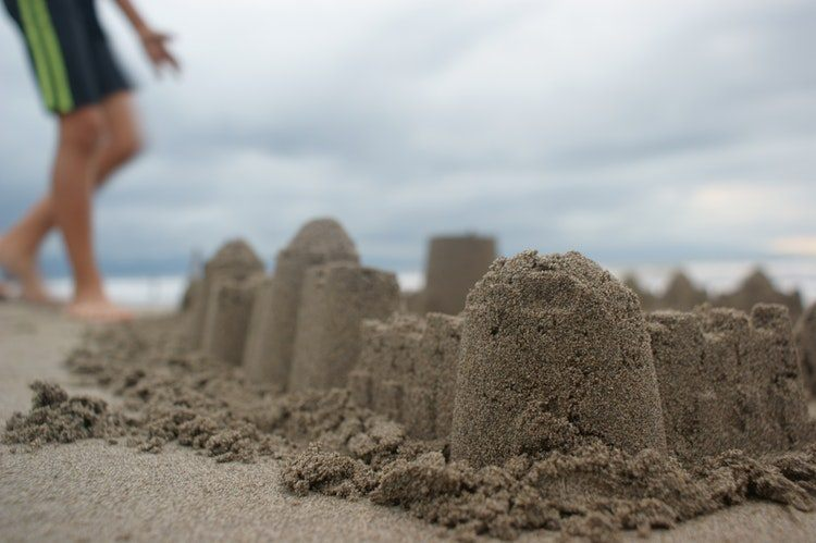 Child and sandcastle