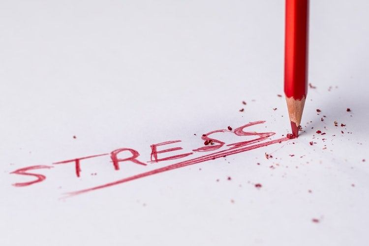 The word stress written on paper