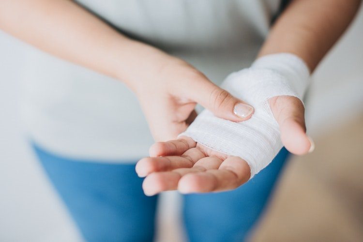 Woman with bandaged hand - Love from Mim